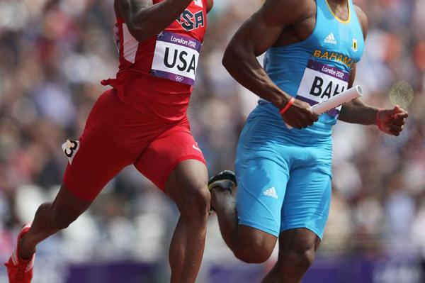 Tony McQuay of the United States and Michael Mathieu of the Bahamas compete during the Men's 4 x 400m Relay Round 1 heats  of the London 2012 Olympic Games on 9 August 2012 (Getty Images)