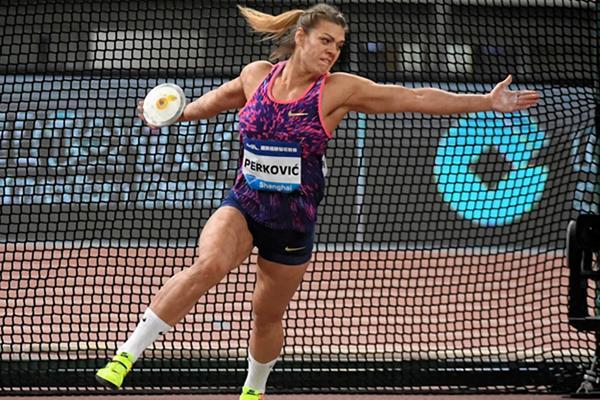 Sandra Perkovic again spinning to victory in Shanghai (Errol Anderson/Jiro Mochizuki)
