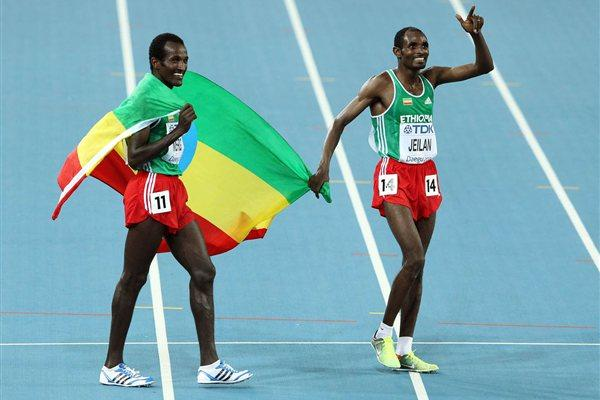 Ibrahim Jeilan (R) and Imane Merga of Ethiopia celebrate after the men's 10,000 metres final during day two  (Getty Images)