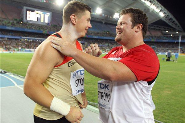 David Storl of Germany is congratulated by Dylan Armstrong of Canada (R) after winning the men's shot put final (Getty Images)