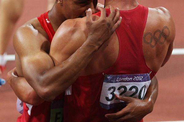 Ashton Eaton (L) of the United States hugs Trey Hardee (R) of the United States after winning gold and silver in the Men's Decathlon event of the London 2012 Olympic Games on 9 August 2012 (Getty Images)