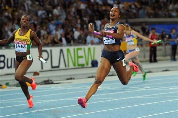 Carmelita Jeter of the USA crosses the finish line to claim victory ahead of Veronica Campbell-Brown of Jamaica in the women's 4x100 metres final  (Getty Images)
