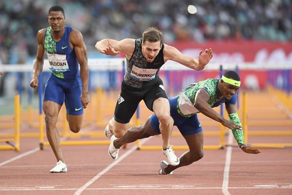 Sergey Shubenkov and Omar McLeod collide in the 110m hurdles at the IAAF Diamond League meeting in Rabat (Kirby Lee)