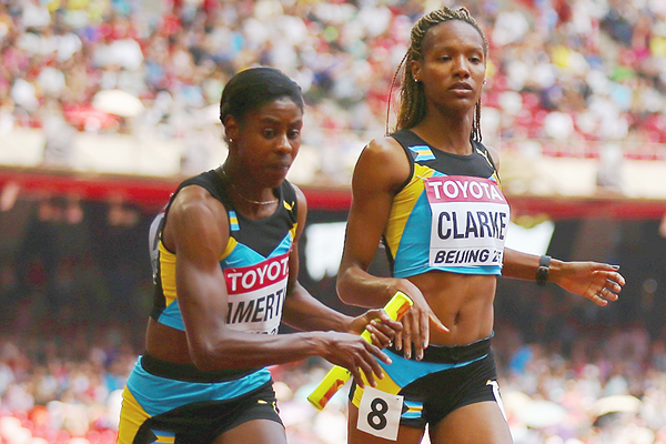 Christine Amertil takes the baton from Lanece Clarke in the 4x400m at the IAAF World Championships Beijing 2015 (Getty Images)