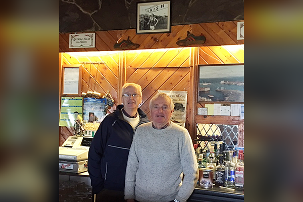 John Treacy (left) with his cousin (right) at the bar where his spikes from the 1978 World Cross have been for the past 41 years (John Treacy)