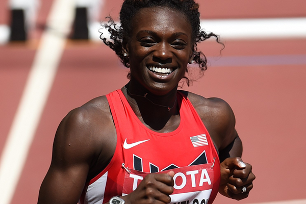Dawn Harper Nelson wins her 100m hurdles heat at the IAAF World Championships (AFP / Getty Images)