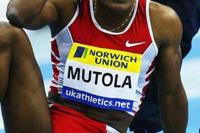 Mutola looks on from the track surface (Getty Images)