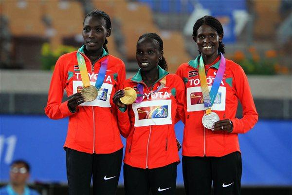 Bronze medalist Linet Chepkwemoi Masai of Kenya, gold medalist Vivian Jepkemoi Cheruiyot of Kenya and silver medalist Sally Kipyego of Kenya celebrate with their medals on the podium after the women's 10000 metres final (Getty Images)