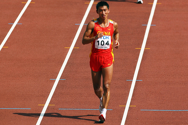 Han Yucheng crosses the finish line in the 50km race walk (Getty Images)