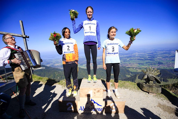 Andrea Mayr (centre) on top of the podium after winning the Adelholzen Hochfelln Mountain Race (Alexis Courthoud)