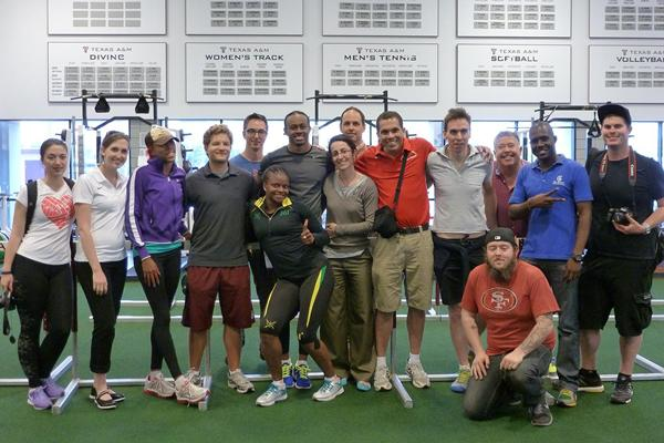 Aries Merritt with his coach, training partners and visiting journalists ()