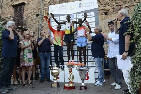 Wilson Kiprop on top of the podium after the 2013 Giro Podistico di Castelbuono (organisers)