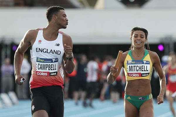 Theo Campbell of England passes Morgan Mitchell of Australia in the mixed 4x400m relay in Melbourne (Getty Images)