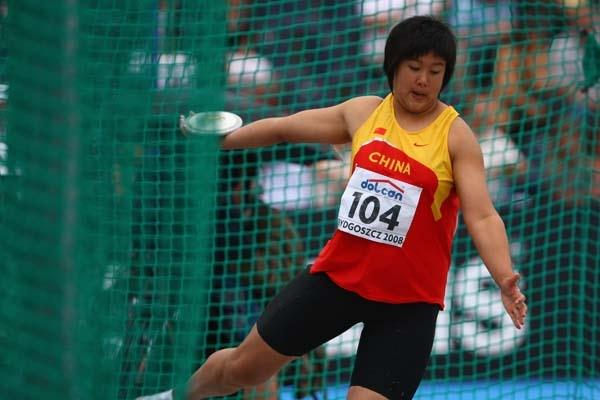 Shangxue Xi of China on her way to winning gold in the Women's Discus Final (Getty Images)