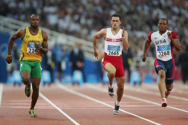 Asafa Powell with Maurice Greene in the men's 100m quarter finals (Getty Images)