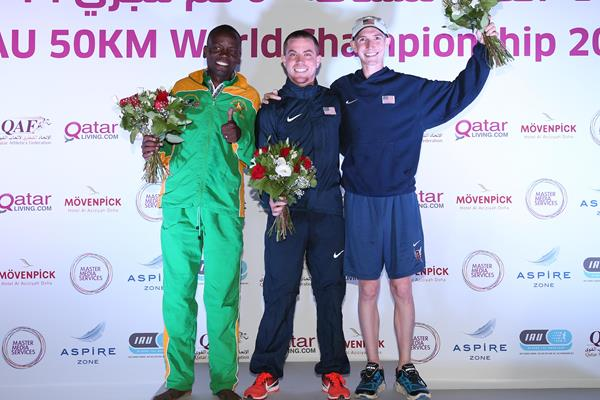 2016 IAU 50km World Championships men's podium: bronze medallist Collen Makaza, winner Tony Migliozzi, and runner-up Tyler Andrews (organisers)
