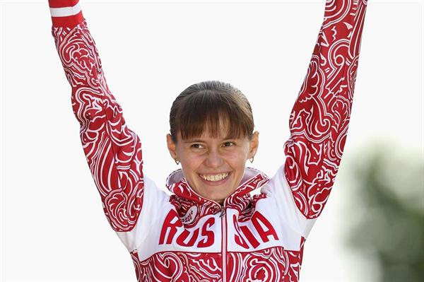 Gold medalist Elena Lashmanova of Russia attends the medal ceremony of the Women's 20km Walk in London on 11 August 2012 (Getty Images)