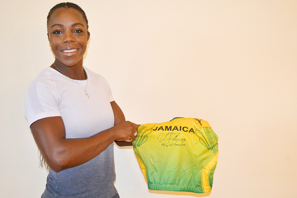 Veronica Campbell-Brown with her vest from the Athens 2004 Olympic Games (IAAF)