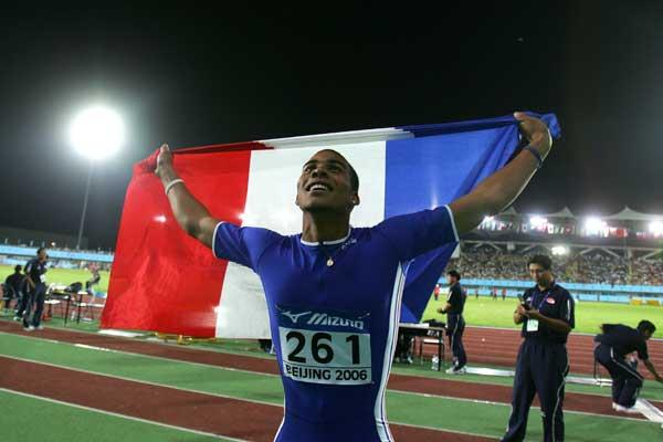 Benjamin Compaore of France celebrates after winning the men's Triple Jump final (Getty Images)