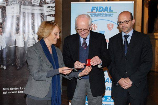 From left : Anna Riccardi member of IAAF Council, Roberto L. Quercetani and Alberto Morini Deputy Vice President FIDAL, taken in Florence - Salone dei Cinquecento - Palazzo Vecchio. March 2012 (FIDAL)