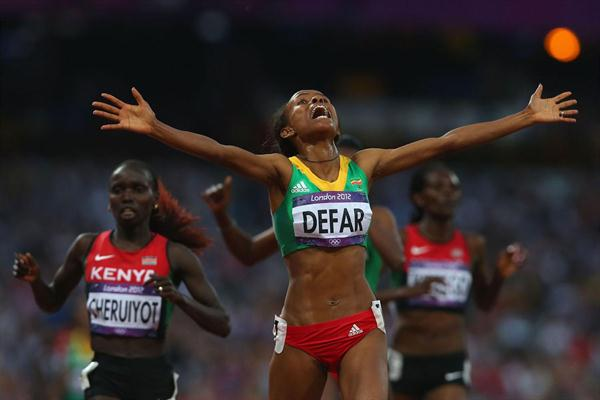 Meseret Defar of Ethiopia crosses the finish line and win gold in the Women's 5000m Final  of the London 2012 Olympic Games  on August 10, 2012 (Getty Images)