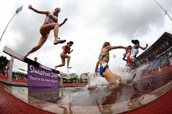 Competition in the girls 2000m steeplechase qualification at Youth Olympic Games (XINHUA / SYOGOC-Pool/ Meng Yongmin)