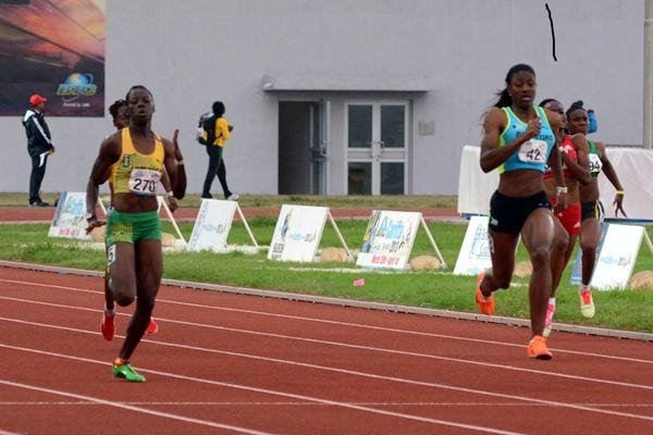 Shaunae Miller of Bahamas (right) on her way to victory in the women's under 20 200m at the 2013 Carifta Games (Anthony Foster)