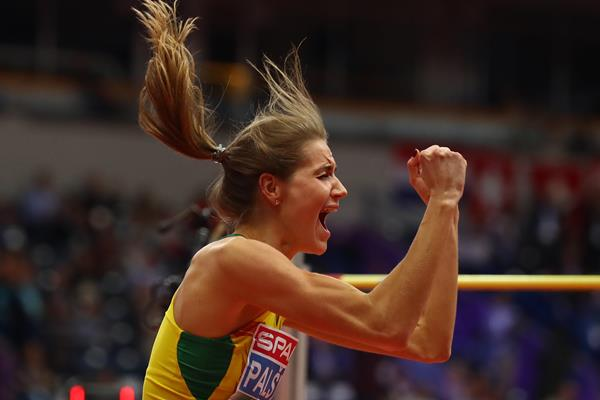Airine Palsyte of Lithuania celebrates her high jump victory at the European Indoor Championships in Belgrade (Getty Images)