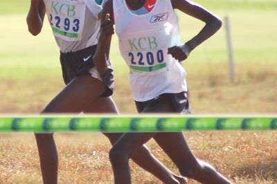 Christine Kambua Muyanga (l) and Chebet Cheptai in the women's junior race at the Kenyan Cross Country Championships; Muyanga won by the thickness of her vest. (Ricky Simms)