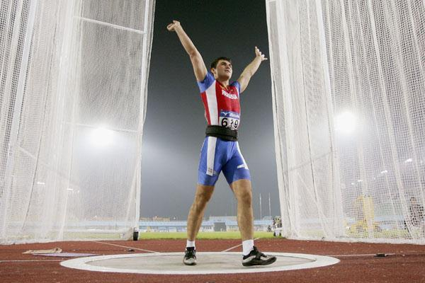 Yevgeniy Aydamirov of Russia celebrates winning the men's Hammer Throw final in Beijing (Getty Images)