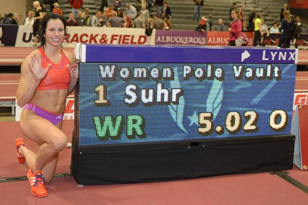 Jenn Suhr next to the scoreboard after breaking the World indoor Pole Vault record with 5.02m (Kirby Lee)