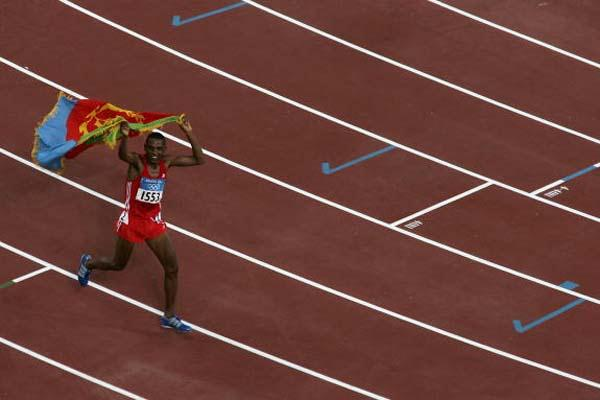 Zersenay Tadesse of Eritrea celebrates winning bronze in the men's 10,000m (Getty Images)