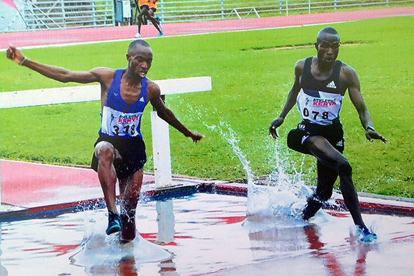 Vincent Kipyegon (right) on his way to winning the steeplechase at the Kenyan Junior Championships (Kip Evans)