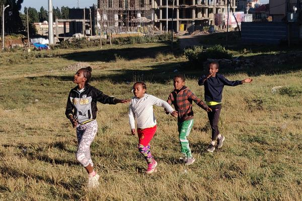 Young runners in a field in the suburbs of Addis Ababa (Cathal Dennehy)