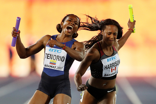 Angela Tenorio of Ecuador and Shaina Harrison of Canada in the 4x100m at the IAAF World Relays (Getty Images)