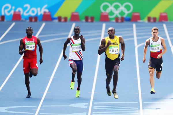 Kyle Greaux (left) and Usain Bolt (second from right) in the 200m heats at the Rio 2016 Olympic Games (Getty Images)