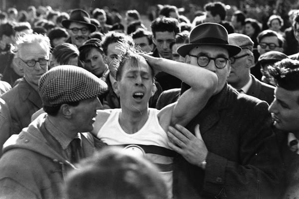 Roger Bannister exhausted after sub-four minute mile ()
