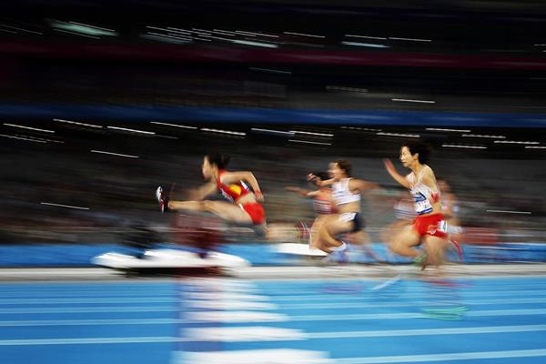 China's Wu Shuijiao on her way to winning the 100m hurdles (Getty Images)
