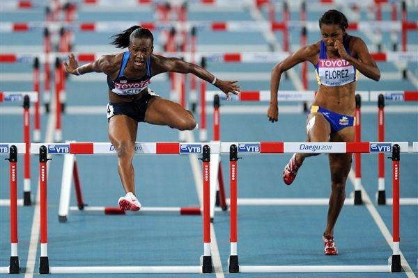 Kellie Wells (L) of United States and Lina Florez of Columbia compete in the women's 100 metres hurdles semi finals  (Getty Images)