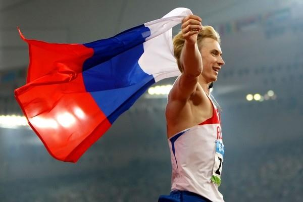 Andrey Silnov celebrates his high jump victory (Getty Images)