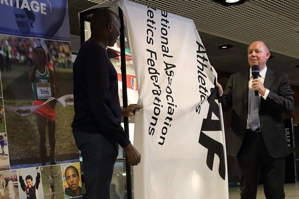 Wilson Kipketer and Chris Turner IAAF Heritage Director, unveil a cabinet at the opening ceremony of the IAAF Heritage XC Display in Aarhus (LOC)