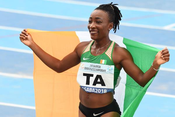 Marie Josee Ta Lou after her double dash victory at the African Championships in Asaba (AFP/Getty Images)