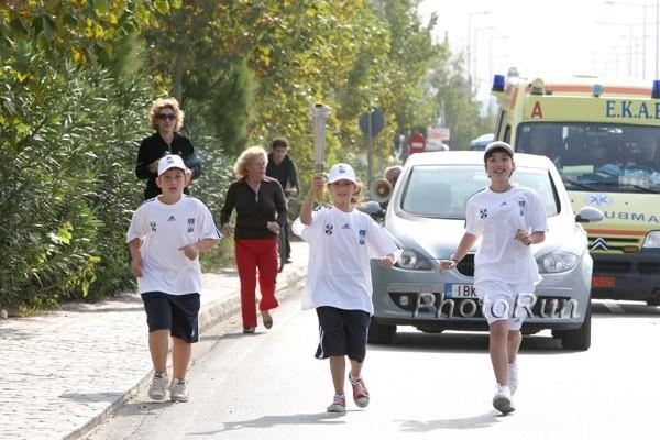 Children run with the 'Marathon Fire' from Marathon Tomb to Marathon on Saturday 8 November (Victah Sailer)