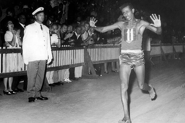 A barefooted Abebe Bikila wins the 1960 Olympic marathon in Rome (Organisers)