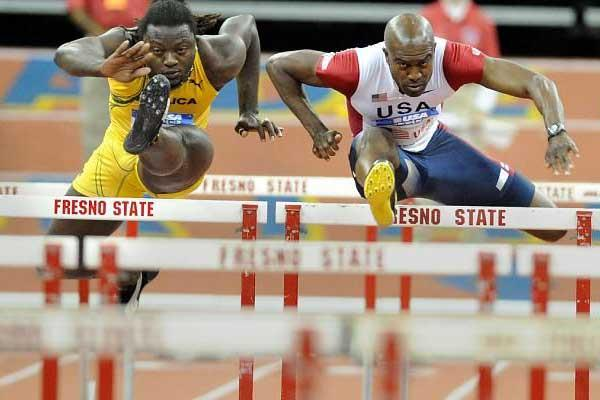 Allen Johnson (USA)  - right - on his way to win the 55m Hurdlers in Fresno (Kirby Lee)