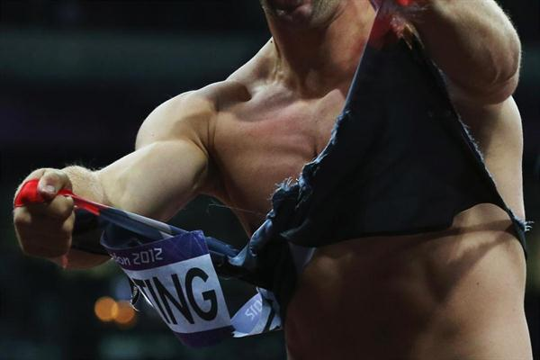 The Men's Discus Throw gold  winner, Robert Harting of Germany celebrates gold  by tearing his shirt  on Day 11 of the London 2012 Olympic Games at Olympic Stadium on August 7, 2012 (Getty Images)
