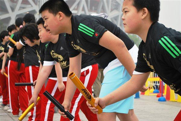 Participants at the '100 Kids - 100 metres - 100 years' event in Beijing Olympic Park to celebrate the year of the IAAF Centenary (organisers)