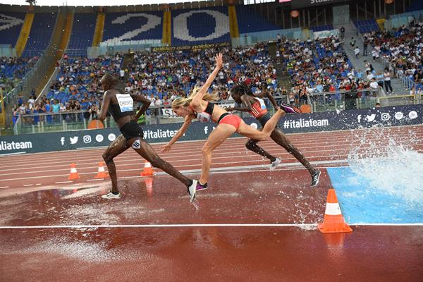 Emma Coburn (c) tumbles over the final water jump in Rome (Hasse Sjogren)