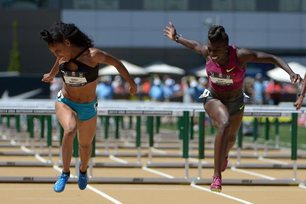 Dawn Harper-Nelson beats Queen Harrison in a close finish in the 100m hurdles at the US Championships (Kirby Lee)