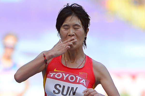 China's Sun Huanhuan crosses the finish line in the 20km race walk (AFP / Getty Images)